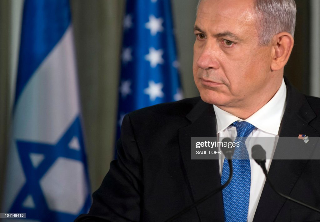 Israeli Prime Minister Benjamin Netanyahu listens to a question during a joint press conference with US President Barack Obama (unseen) at the Prime Minister's Residence in Jerusalem, March 20, 2013, on the first day of Obama's three day trip to Israel and the Palestinian Territories. AFP PHOTO / Saul LOEB