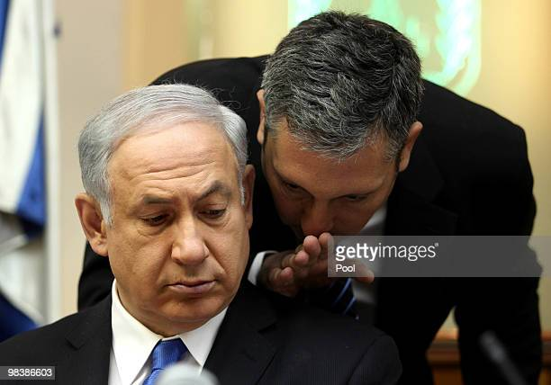 Israeli Prime Minister Benjamin Netanyahu listens to an adviser during the weekly cabinet meeting at his office on April 11 2010 in Jerusalem Israel...