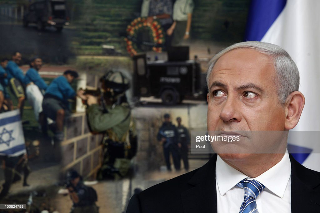 Israeli Prime Minister <a gi-track='captionPersonalityLinkClicked' href=/galleries/search?phrase=Benjamin+Netanyahu&family=editorial&specificpeople=118594 ng-click='$event.stopPropagation()'>Benjamin Netanyahu</a> looks on during a visit to the national police headquarters on November 22, 2012 in Jerusalem, Israel. A ceasefire took hold on November 21 in and around Gaza after a week of cross-border violence between Israel and Palestinian militants, although a police spokesman reported that twelve rockets fired from the Gaza Strip hit Israel in the hours that followed the agreement.