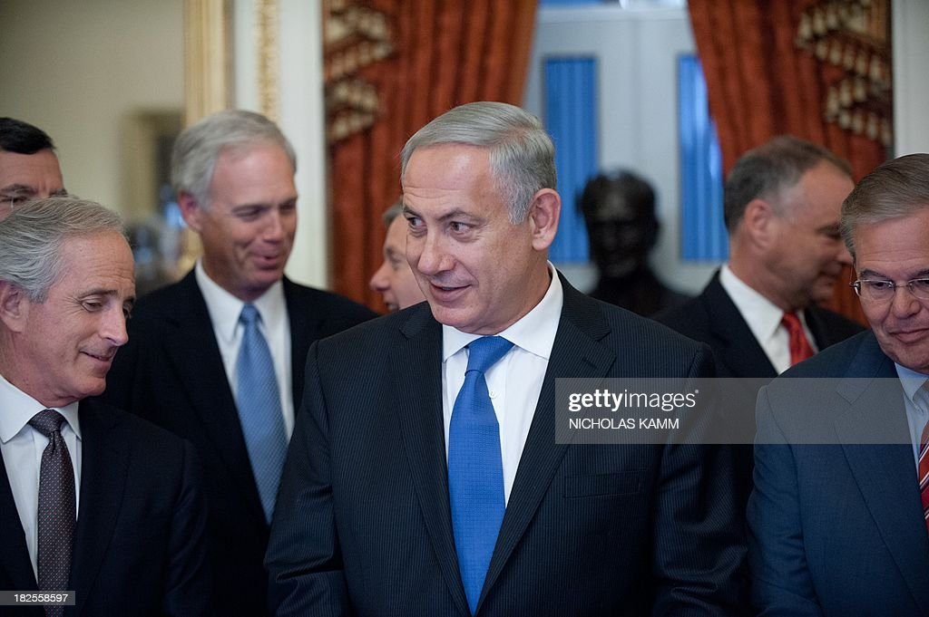 Israeli Prime Minister Benjamin Netanyahu (C) looks on prior to a meeting with members of the US Senate Foreign Relations Committee at the Capitol on September 30, 2013. AFP PHOTO/Nicholas KAMM