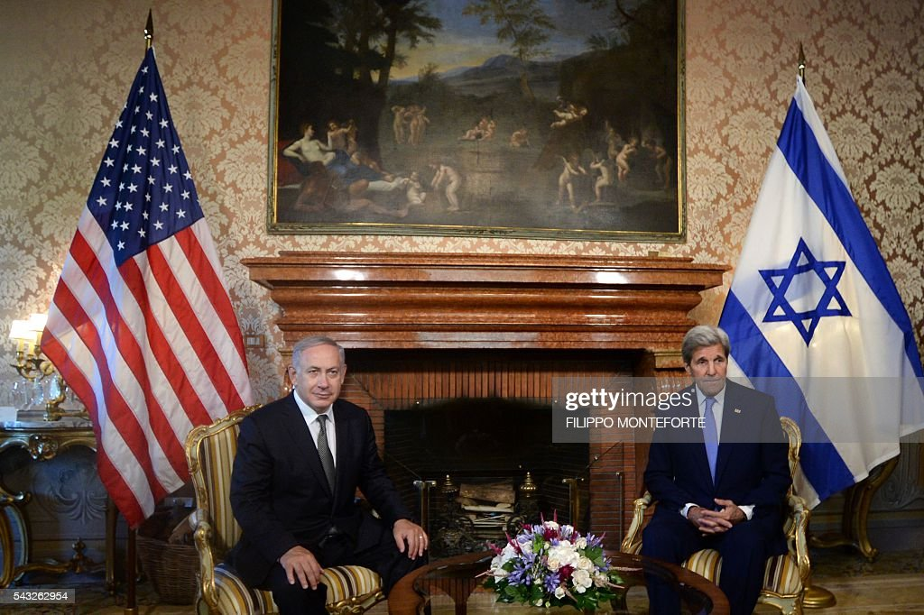 Prime Minister Benjamin Netanyahu (L) meets US Secretary of State John Kerry on June 27, 2016 at Villa Taverna, US ambassador's residence in Rome. Netanyahu confirmed that Israel has agreed a deal to thaw relations with Turkey and said that it would be a huge boost for the economy. Speaking in Rome after talks with US Secretary of State John Kerry, Netanyahu told reporters: 'I think it's an important step here to normalize relations.' / AFP / Filippo MONTEFORTE