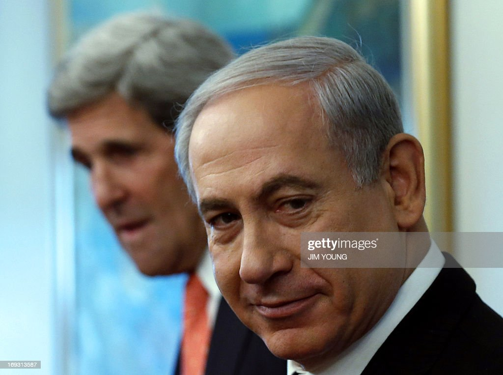 Israeli Prime Minister Benjamin Netanyahu meets with US Secretary of State John Kerry (back) in Jerusalem on May 23, 2013. Kerry flew in to Jerusalem as he kept up a push to bring Israelis and Palestinians back to peace negotiations amid a growing scepticism over his efforts.