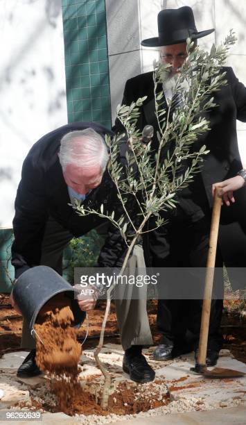 Israeli Prime Minister Benjamin Netanyahu plants a tree during an event marking Israel's Arbour day in the West Bank Jewish settlement of Ariel...
