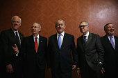 Israeli Prime Minister Benjamin Netanyahu poses for photographers with US Senate Majority Leader Sen Mitch McConnell Senate Minority Leader Sen Harry...