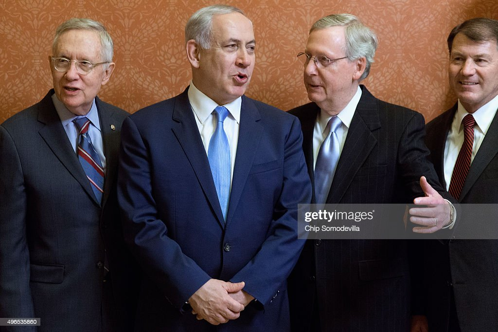 Israeli Prime Minister Benjamin Netanyahu (2nd L) poses for photographs with U.S. Senate Majority Leader Mitch McConnell (R-KY) (2nd R), Senate Minority Leader Harry Reid (D-NV) (L) and Sen. Mike Rounds (R-SD) in in the Strom Thurmond Room at the U.S. Capitol November 10, 2015 in Washington, DC. Netanyahu met with U.S. President Barack Obama a day earlier when the two leaders talked about fighting terrorism, the conflict in Syria and healing their rift over the Iran nuclear deal.