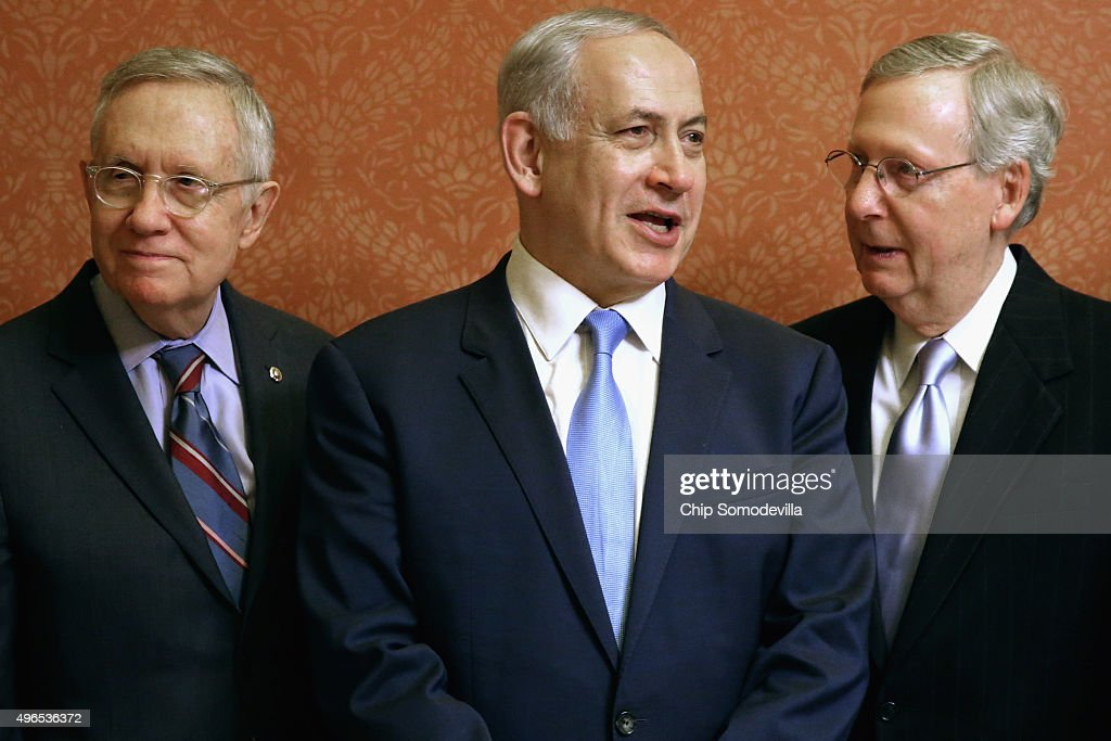 Israeli Prime Minister Benjamin Netanyahu (C) poses for photographs with U.S. Senate Majority Leader Mitch McConnell (R-KY) (R) and Senate Minority Leader Harry Reid (D-NV) in in the Strom Thurmond Room at the U.S. Capitol November 10, 2015 in Washington, DC. Netanyahu met with U.S. President Barack Obama a day earlier when the two leaders talked about fighting terrorism, the conflict in Syria and healing their rift over the Iran nuclear deal.