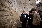 Israeli Prime Minister Benjamin Netanyahu prays with his sons Yair Netanyahu and Avner Netanyahu at the Western Wall Judaism holiest site on January...