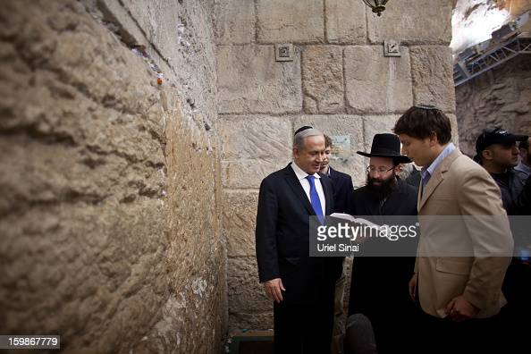 Israeli Prime Minister Benjamin Netanyahu prays with his sons Yair Netanyahu and Avner Netanyahu at the Western Wall Judaism holiest site on January...