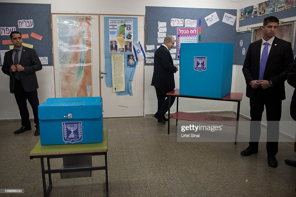 Israeli Prime Minister Benjamin Netanyahu prepares to cast his ballot at a polling station on election day on January 22, 2013 in Jerusalem, Israel. Israel's general election voting has begun today as polls show Netanyahu is expected to return to office with a narrow majority.