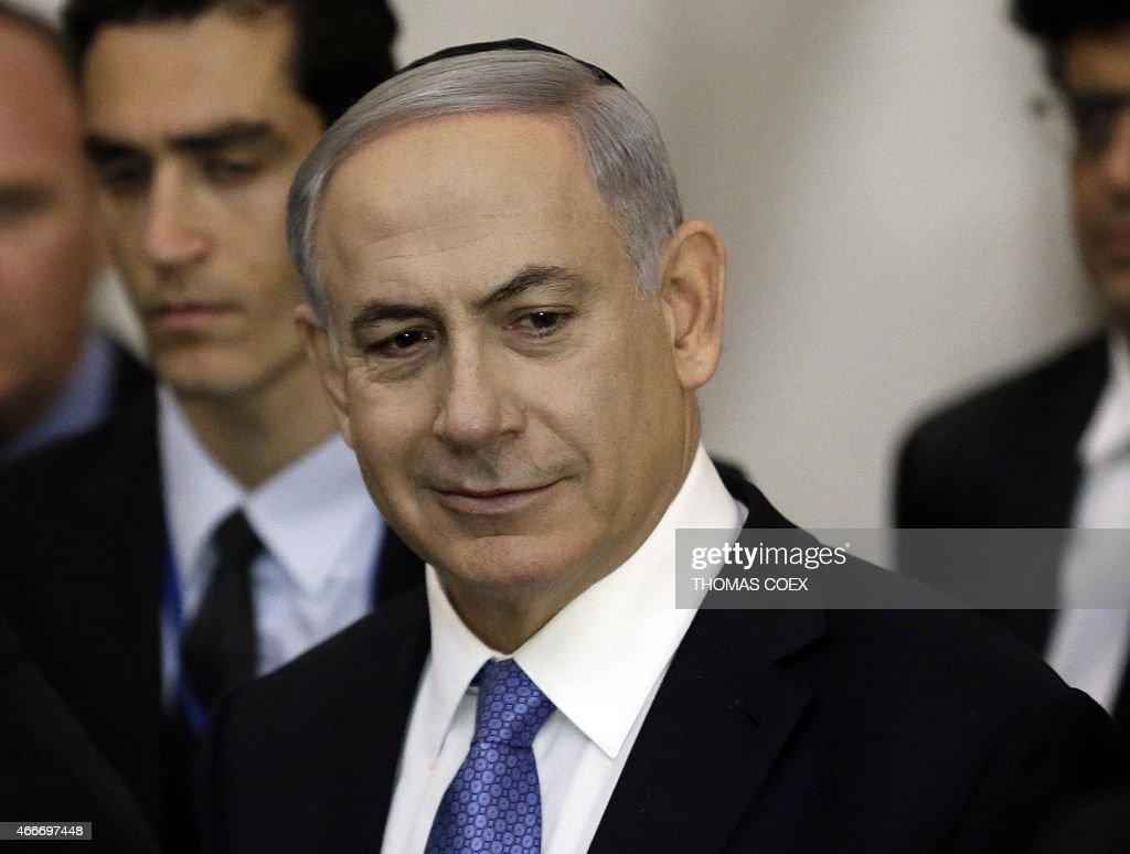 Israeli Prime Minister <a gi-track='captionPersonalityLinkClicked' href=/galleries/search?phrase=Benjamin+Netanyahu&family=editorial&specificpeople=118594 ng-click='$event.stopPropagation()'>Benjamin Netanyahu</a> reacts as he visits, on March 18, 2015, at the Wailing Wall in Jerusalem following his party Likud's victory in Israel's general election. Netanyahu swept to a stunning election victory, securing a third straight term for an Israeli leader who has deepened tensions with the Palestinians and infuriated key ally Washington. AFP PHOTO / THOMAS COEX