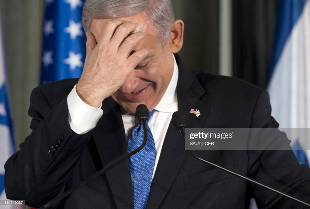Israeli Prime Minister Benjamin Netanyahu reacts during a joint press conference with US President Barack Obama (unseen) at the Prime Minister's Residence in Jerusalem, March 20, 2013, on the first day of Obama's three day trip to Israel and the Palestinian Territories. AFP PHOTO / Saul LOEB