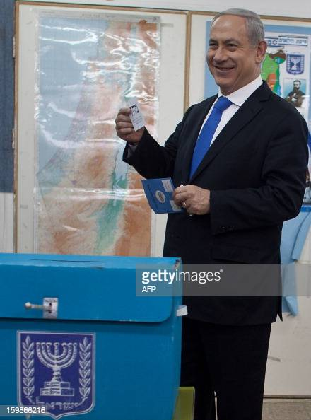 Israeli Prime Minister Benjamin Netanyahu readies to cast his ballot at a polling station in Jerusalem on January 22 as Israel residents started to...
