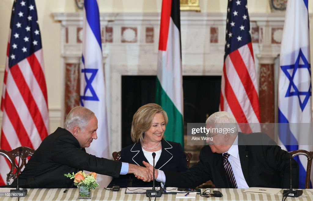 Israeli Prime Minister Benjamin Netanyahu (L) shakes hands with Palestinian Authority President Mahmoud Abbas (R) as U.S. Secretary of State Hillary Rodham Clinton (C) looks on during the opening of the re-launch of direct negotiations for peace at the State Department September 2, 2010 in Washington, DC. The Israeli and Palestinian leaders have started a new round of peace talks in Washington, the first one in more than 18 months.