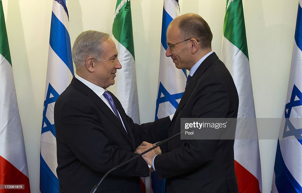Israeli Prime Minister <a gi-track='captionPersonalityLinkClicked' href=/galleries/search?phrase=Benjamin+Netanyahu&family=editorial&specificpeople=118594 ng-click='$event.stopPropagation()'>Benjamin Netanyahu</a> (L) shakes hands with Italy's Prime Minister <a gi-track='captionPersonalityLinkClicked' href=/galleries/search?phrase=Enrico+Letta&family=editorial&specificpeople=2915592 ng-click='$event.stopPropagation()'>Enrico Letta</a> before their meeting July 1, 2013 in Jerusalem, Israel. The two leaders reportedly talked about peace talks between the Israeli's and Palestinians and the Iranian nuclear weapons program.