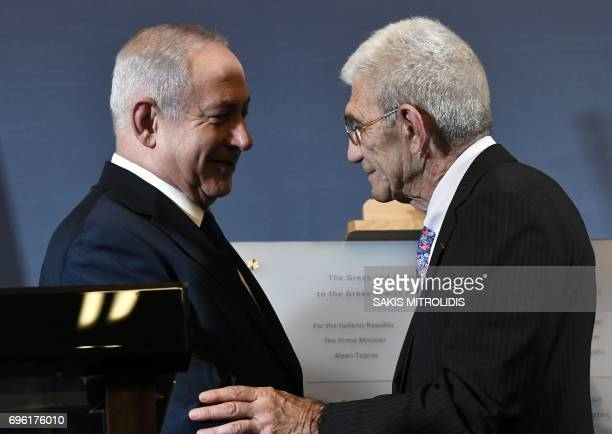 Israeli Prime Minister Benjamin Netanyahu shakes hands with Mayor of Thessaloniki Giannis Boutaris during the presentation of a memorial plaque at...