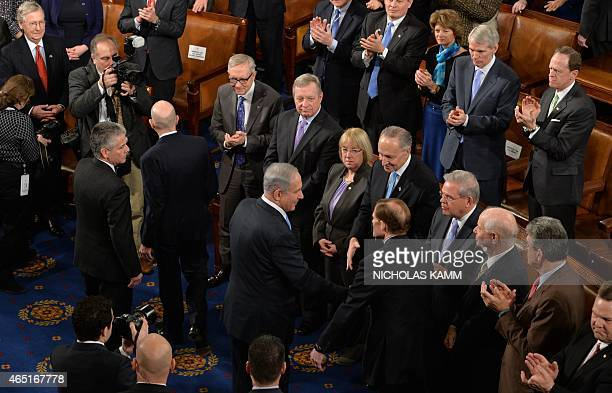 Israeli Prime Minister Benjamin Netanyahu shakes hands with members of Congress after he addressed a joint meeting of the US Congress at the Capitol...