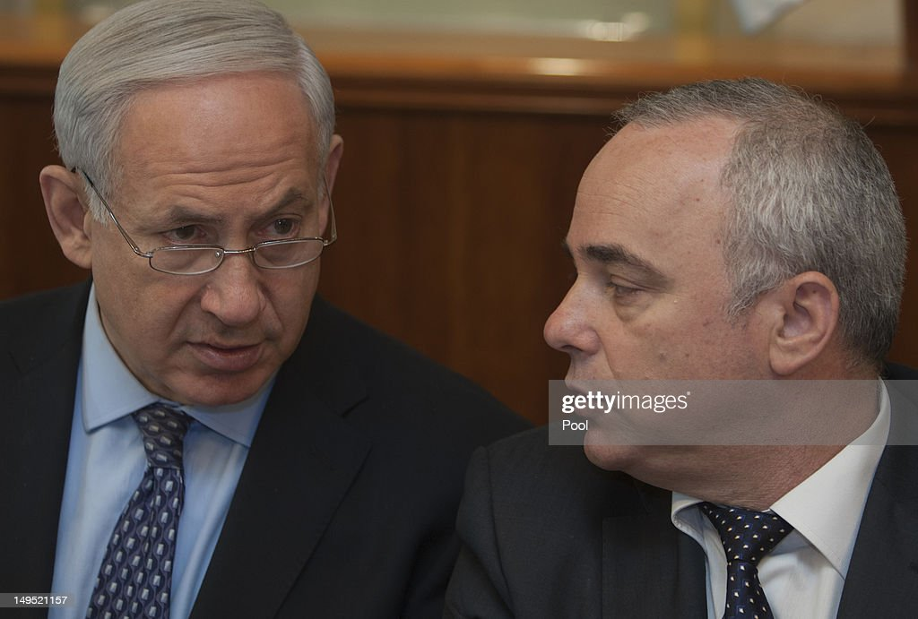 Israeli Prime Minister <a gi-track='captionPersonalityLinkClicked' href=/galleries/search?phrase=Benjamin+Netanyahu&family=editorial&specificpeople=118594 ng-click='$event.stopPropagation()'>Benjamin Netanyahu</a> (L) sits together with Finance Minister Yuval Steinitz as they attend the weekly cabinet meeting in his Jerusalem office on July 30, 2012 in Jerusalem, Israel.