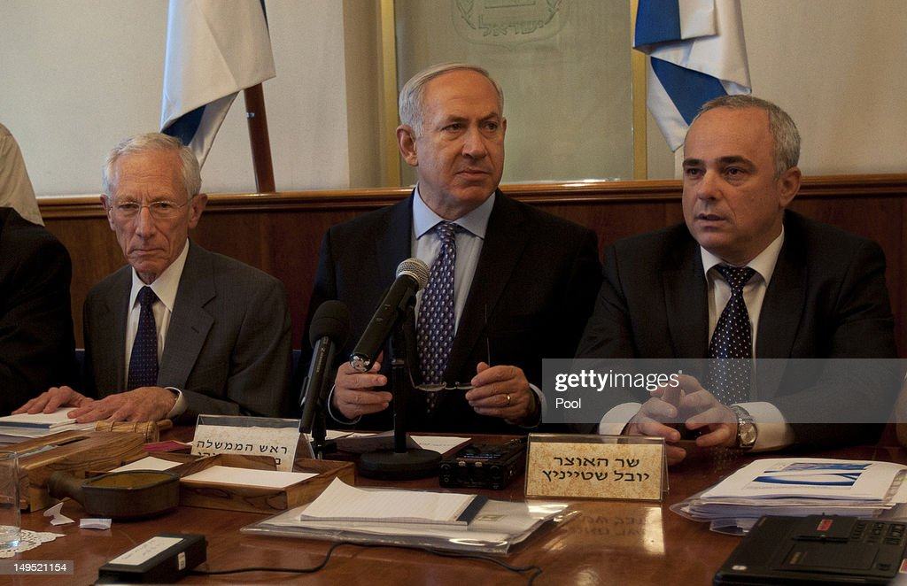 Israeli Prime Minister <a gi-track='captionPersonalityLinkClicked' href=/galleries/search?phrase=Benjamin+Netanyahu&family=editorial&specificpeople=118594 ng-click='$event.stopPropagation()'>Benjamin Netanyahu</a> (C) sits together with Governor of the Central Bank of Israel <a gi-track='captionPersonalityLinkClicked' href=/galleries/search?phrase=Stanley+Fischer&family=editorial&specificpeople=233518 ng-click='$event.stopPropagation()'>Stanley Fischer</a> (L) and Finance Minister Yuval Steinitz as they attend the weekly cabinet meeting in his Jerusalem office on July 30, 2012 in Jerusalem, Israel.