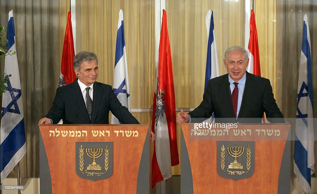 Israeli Prime Minister Benjamin Netanyahu (R) smiles as Austrian Chancellor <a gi-track='captionPersonalityLinkClicked' href=/galleries/search?phrase=Werner+Faymann&family=editorial&specificpeople=4101130 ng-click='$event.stopPropagation()'>Werner Faymann</a> listens to him during a joint statement to the press at Netanyahu's residence June 23, 2010 in Jerusalem, Israel. Faymann is the first foreign leader to meet with Prime Minister Benjamin Netanyahu since the Gaza flotilla raid in May.