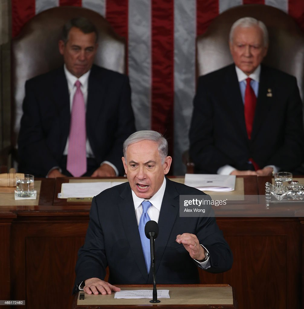 Israeli Prime Minister <a gi-track='captionPersonalityLinkClicked' href=/galleries/search?phrase=Benjamin+Netanyahu&family=editorial&specificpeople=118594 ng-click='$event.stopPropagation()'>Benjamin Netanyahu</a> speaks about Iran during a joint meeting of the United States Congress in the House chamber at the U.S. Capitol March 3, 2015 in Washington, DC. At the risk of further straining the relationship between Israel and the Obama Administration, Netanyahu warned members of Congress against what he considers an ill-advised nuclear deal with Iran. Also pictured are House Speaker <a gi-track='captionPersonalityLinkClicked' href=/galleries/search?phrase=John+Boehner&family=editorial&specificpeople=274752 ng-click='$event.stopPropagation()'>John Boehner</a> (R-OH)(L) and Sen. Orrin Hatch (R-Ut).