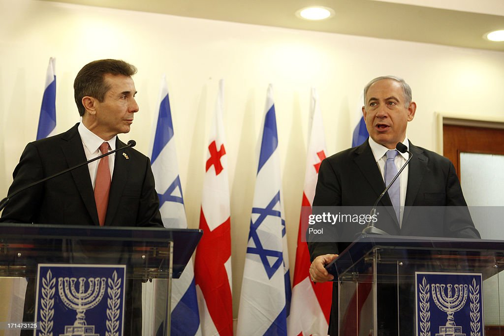 Israeli Prime Minister <a gi-track='captionPersonalityLinkClicked' href=/galleries/search?phrase=Benjamin+Netanyahu&family=editorial&specificpeople=118594 ng-click='$event.stopPropagation()'>Benjamin Netanyahu</a> (R) speaks as Georgian Prime Minister Bidzina Ivanishvili listens on June 25, 2013 in Jerusalem, Israel. Georgian Prime Minister Bidzina was in Israel to discuss an economic cooperation agreement with Israel ahead of his retirement from politics following the presidential elections in Georgia in October this year.