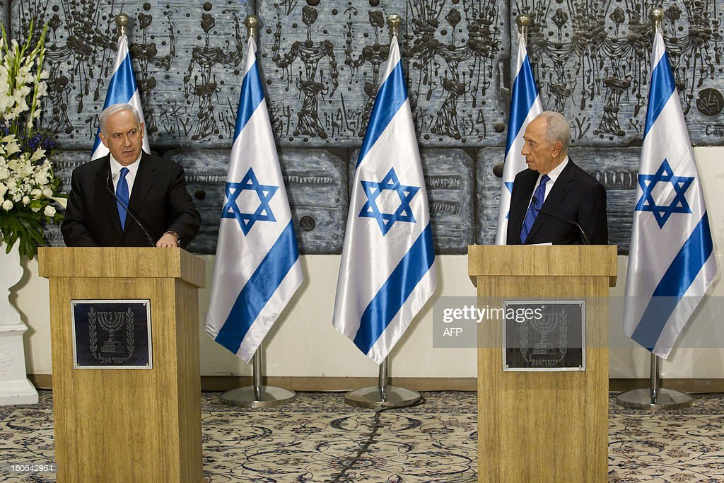 Israeli Prime Minister Benjamin Netanyahu (L) speaks as Israeli President Shimon Peres listens on during a short speech in a brief ceremony in the President's Jerusalem residence, on February 2, 2013. Peres tasked Netanyahu with forming a new government after two days of intense talks with the parties recently elected to the new parliament.