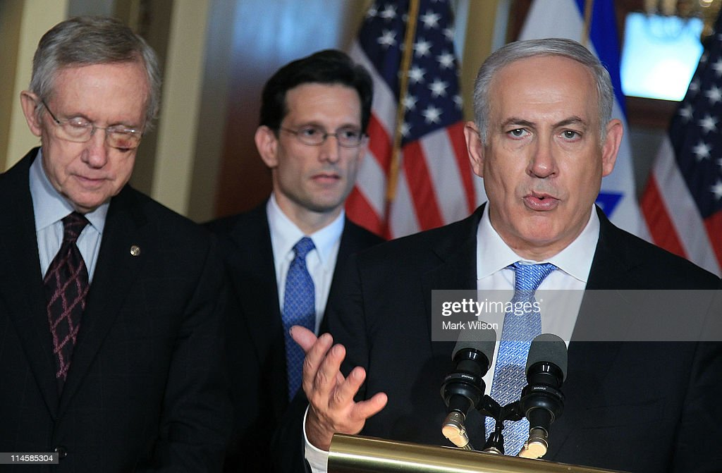 Israeli Prime Minister <a gi-track='captionPersonalityLinkClicked' href=/galleries/search?phrase=Benjamin+Netanyahu&family=editorial&specificpeople=118594 ng-click='$event.stopPropagation()'>Benjamin Netanyahu</a> (R), speaks as Senate Majority Leader <a gi-track='captionPersonalityLinkClicked' href=/galleries/search?phrase=Harry+Reid+-+Politician&family=editorial&specificpeople=203136 ng-click='$event.stopPropagation()'>Harry Reid</a> (D-NV) (L) and U.S. Rep. <a gi-track='captionPersonalityLinkClicked' href=/galleries/search?phrase=Eric+Cantor&family=editorial&specificpeople=653711 ng-click='$event.stopPropagation()'>Eric Cantor</a> (R-VA) listen while addressing the media at the U.S Capitol on May 24, 2011 in Washington, DC. Netanyahu had earlier delivered a speech to a joint meeting of Congress.