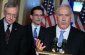 Israeli Prime Minister Benjamin Netanyahu speaks as Senate Majority Leader Harry Reid and US Rep Eric Cantor listen while addressing the media at the...