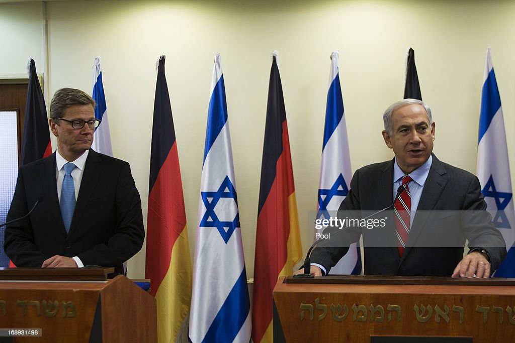 Israeli Prime Minister <a gi-track='captionPersonalityLinkClicked' href=/galleries/search?phrase=Benjamin+Netanyahu&family=editorial&specificpeople=118594 ng-click='$event.stopPropagation()'>Benjamin Netanyahu</a> (R) speaks during a joint press conference with German Foreign Minister <a gi-track='captionPersonalityLinkClicked' href=/galleries/search?phrase=Guido+Westerwelle&family=editorial&specificpeople=208748 ng-click='$event.stopPropagation()'>Guido Westerwelle</a> before their meeting on May 17, 2013 in Jerusalem, Israel. Westerwelle is on two-day trip to Israel and the Palestinian territories, aimed at promoting a new start to peace talks.