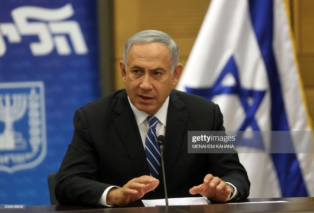 Israeli Prime Minister Benjamin Netanyahu speaks during a meeting of his Likud party at the Knesset (parliament) in Jerusalem on May 30, 2016. Netanyahu's cabinet approved the entry of ultra-nationalist Avigdor Lieberman to the ruling coalition as defence minister, after defusing opposition from another partner, the government said. / AFP / MENAHEM