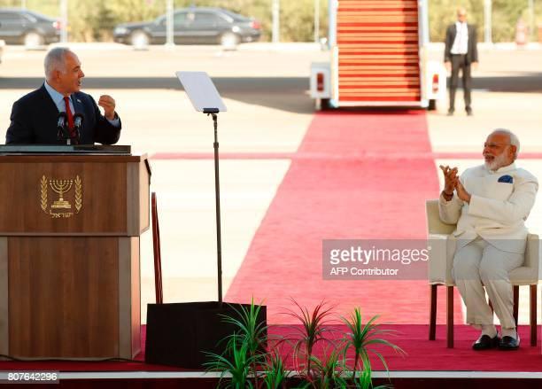 Israeli Prime Minister Benjamin Netanyahu speaks during a welcoming ceremony for his Indian counterpart Narendra Modi at BenGurion International...