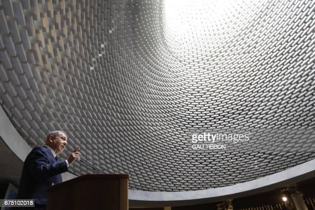TOPSHOT Israeli Prime Minister Benjamin Netanyahu speaks during an event for the dedication of a new memorial wall for Israels fallen servicemen and...