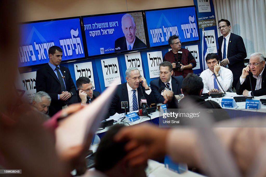 Israeli Prime Minister Benjamin Netanyahu (4th L) speaks on the phone with potential voters ahead of the upcoming Israeli elections on January 17, 2013. in Tel Aviv, Israel. Israeli elections are scheduled for January 22 and so far showing a majority for the Israeli right.