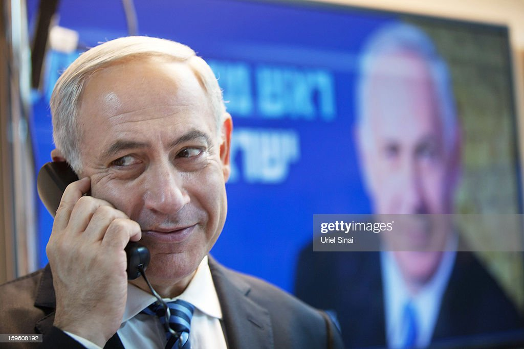 Israeli Prime Minister Benjamin Netanyahu speaks on the phone with potential voters ahead of the upcoming Israeli elections on January 17, 2013. in Tel Aviv, Israel. Israeli elections are scheduled for January 22 and so far showing a majority for the Israeli right.