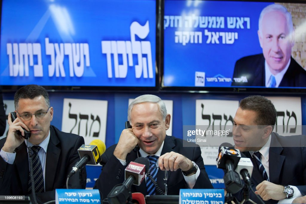 Israeli Prime Minister Benjamin Netanyahu (C) speaks on the phone with potential voters ahead of the upcoming Israeli elections on January 17, 2013. in Tel Aviv, Israel. Israeli elections are scheduled for January 22 and so far showing a majority for the Israeli right.