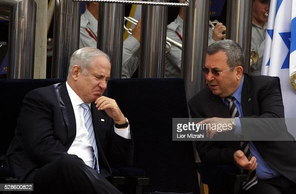 Israeli Prime Minister Benjamin Netanyahu speaks to Defence Minister Ehud Barak during a Independence Day Ceremony at the President house on April 29...