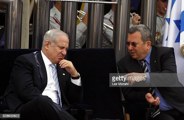 Israeli Prime Minister Benjamin Netanyahu speaks to Defence Minister Ehud Barak during a Independence Day Ceremony at the President house on April 29...