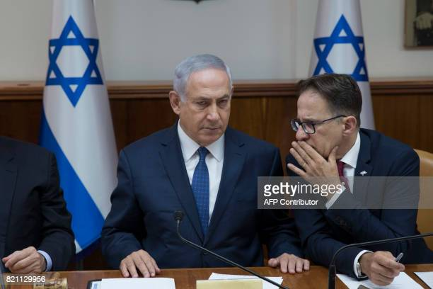 TOPSHOT Israeli Prime Minister Benjamin Netanyahu speaks with Government Secretary Tzachi Braverman during the weekly cabinet meeting at his office...