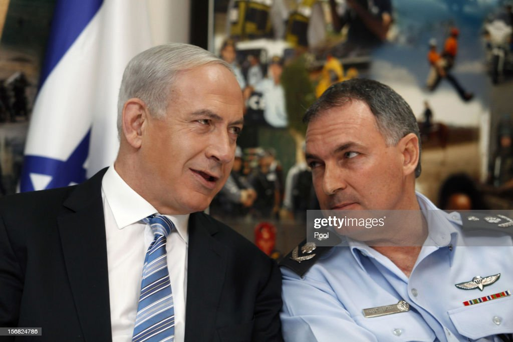 Israeli Prime Minister Benjamin Netanyahu (L) speaks with the head of the Israeli Police, Major General Yohanan Danino, during his visit to the national police headquarters on November 22, 2012 in Jerusalem, Israel. A ceasefire took hold on November 21 in and around Gaza after a week of cross-border violence between Israel and Palestinian militants, although a police spokesman reported that twelve rockets fired from the Gaza Strip hit Israel in the hours that followed the agreement.