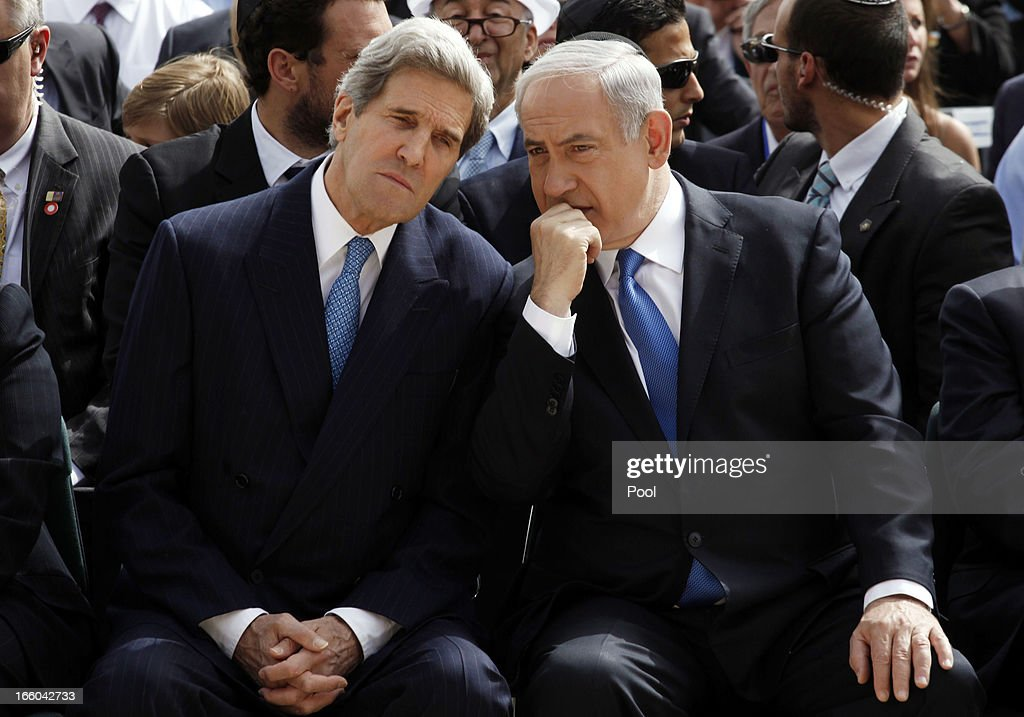 Israeli Prime Minister <a gi-track='captionPersonalityLinkClicked' href=/galleries/search?phrase=Benjamin+Netanyahu&family=editorial&specificpeople=118594 ng-click='$event.stopPropagation()'>Benjamin Netanyahu</a> (R) speaks with U.S. Secretary of State <a gi-track='captionPersonalityLinkClicked' href=/galleries/search?phrase=John+Kerry&family=editorial&specificpeople=154885 ng-click='$event.stopPropagation()'>John Kerry</a> during the annual ceremony for the Holocaust Remembrance day at the Yad Vashem memorial on April 8, 2013 in Jerusalem, Israel. Across the world, people commemorated the six million Jews murdered by the Nazi regime during World War II between 1933 and 1945. U.S. Secretary of State <a gi-track='captionPersonalityLinkClicked' href=/galleries/search?phrase=John+Kerry&family=editorial&specificpeople=154885 ng-click='$event.stopPropagation()'>John Kerry</a>'s visit is in an attempt to restart mideast peace talks between Israeli and Palestinians officials.