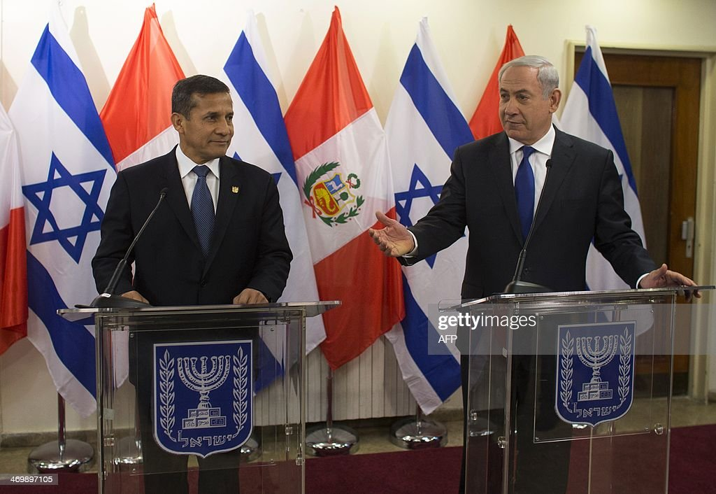 Israeli Prime Minister Benjamin Netanyahu (R) stands next to Peru's President Ollanta Humala during their joint press conference in Jerusalem on February 17, 2014. Humala is on a three-day visit to Israel.