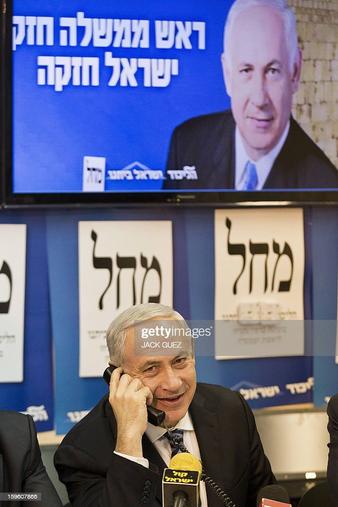 Israeli Prime Minister Benjamin Netanyahu talks to potentiel voters in an attempt to convince them to vote for his party in Tel Aviv on January 17, 2013. Thirty-eight parties on 34 lists will battle for seats in the next Knesset, reflecting the country's eclectic political map. AFP PHOTO / JACK GUEZ