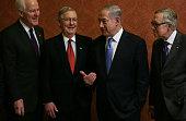 Israeli Prime Minister Benjamin Netanyahu talks to US Senate Majority Leader Sen Mitch McConnell and Senate Majority Whip Sen John Cornyn as Senate...