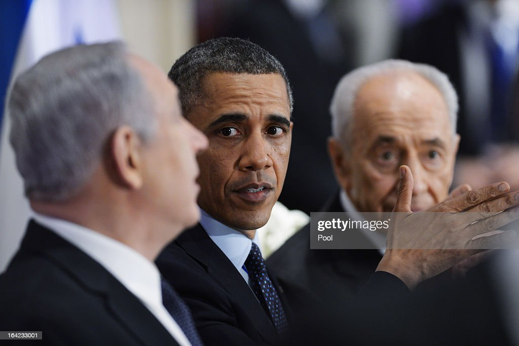 Israeli Prime Minister Benjamin Netanyahu, U.S. President Barack Obama and Israeli Preisident Shimon Peres sit at a state dinnner at Peres' official residence March 21, 2013 in Jerusalem, Israel. This is Obama's first visit as president to the region and his itinerary includes meetings with the Palestinian and Israeli leaders as well as a visit to the Church of the Nativity in Bethlehem.