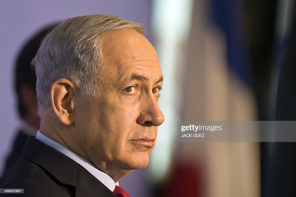 Israeli Prime Minister Benjamin Netanyahu visits a French-Israeli technology innovation summit at a hotel in the Mediterranean coastal city of Tel Aviv on November 19, 2013, along with French President Francois Hollande who wrapped up a three-day trip to Israel and the Palestinian territories by attending the technology event and meeting French community members.