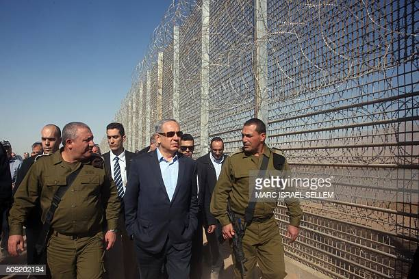 Israeli Prime Minister Benjamin Netanyahu visits the construction site of a new military border fence between Israel and Jordan on February 9 2016...