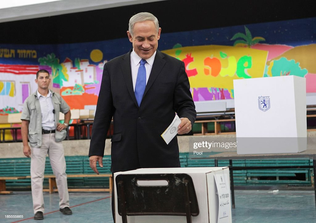 Israeli Prime Minister Benjamin Netanyahu votes in the municipal elections on October 22 2013 in Jerusalem Israel The incumbent mayors of both of...