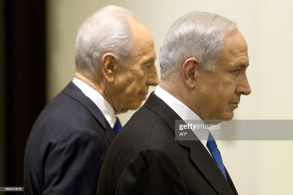Israeli Prime Minister Benjamin Netanyahu (R) walks with Israeli President Simon Peres as they leave a hall in the president's Jerusalem residence, on February 2, 2013, after Peres tasked Netanyahu with forming a new government after two days of intense talks with the parties recently elected to the new parliament.
