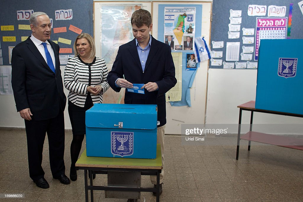 Israeli Prime Minister Benjamin Netanyahu watches his son Yair Netanyahu cast his ballot with by wife Sara Netanyahu at a polling station on election day on January 22, 2013 in Jerusalem, Israel. Israel's general election voting has begun today as polls show Netanyahu is expected to return to office with a narrow majority.