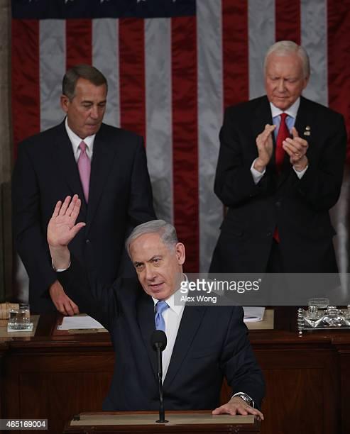 Israeli Prime Minister Benjamin Netanyahu waves after speaking about Iran during a joint meeting of the United States Congress in the House chamber...